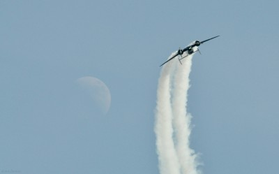 Twin Beech loops past the moon at AirVenture 2012