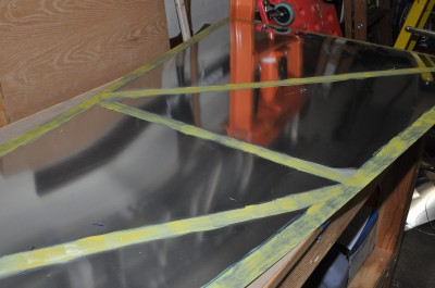 Close up of contact adhesive on fuselage skin.