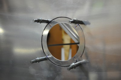 Inspection port with backing ring