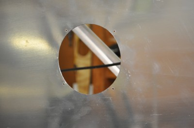 Hole cut in fuselage skin