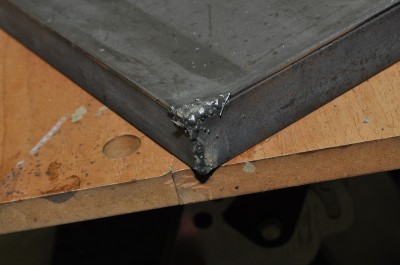 Close-up of the corner of my welding tabletop