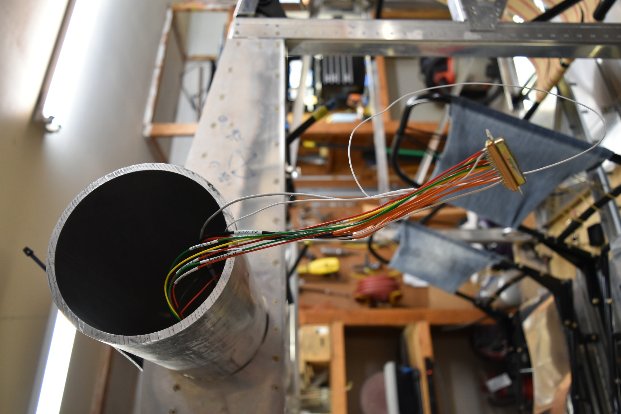Wiring harness hanging out of Bede BD-4C spar tube