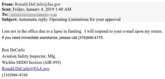 """""""I am not in the office due to a lapse in funding"""" automatic reply email message"""